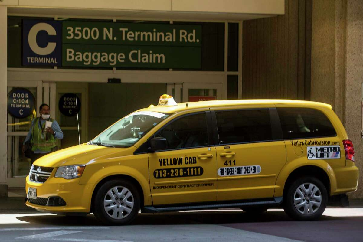 A Yellow Cab taxi waits for fares outside George Bush Intercontinental Airport on May 18, 2020 in Houston. Yellow Cab on July 19 confirmed it was filing for bankruptcy.