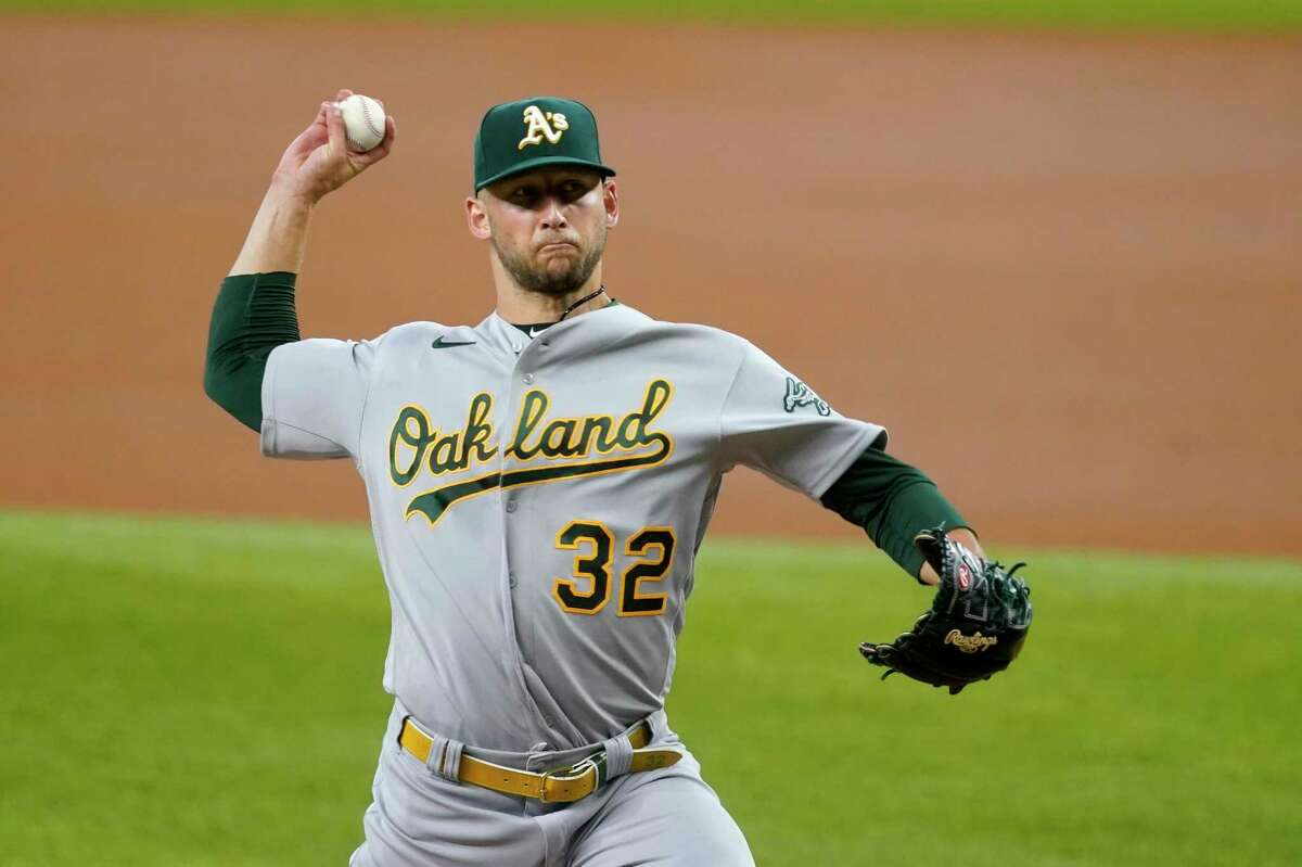 Oakland Athletics starting pitcher James Kaprielian throws to the Texas Rangers in the first inning of a baseball game in Arlington, Texas, Saturday, July 10, 2021. (AP Photo/Tony Gutierrez)