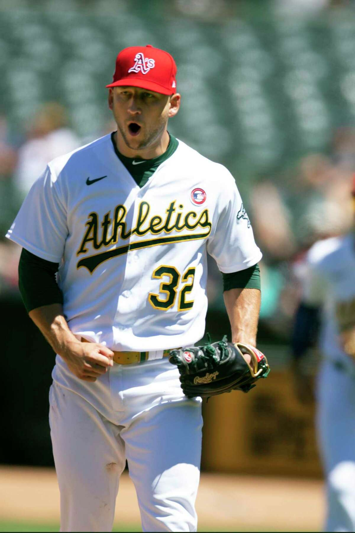 Oakland Athletics starting pitcher James Kaprielian (32) reacts after striking out Boston Red Sox's Michael Chavis to end the top half of the seventh inning of a baseball game, Sunday, July 4, 2021, in Oakland, Calif. (AP Photo/D. Ross Cameron)