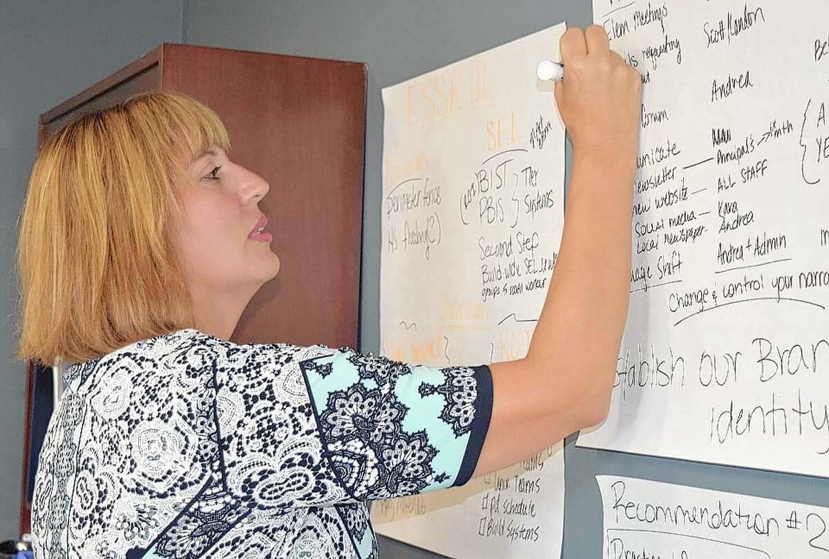 Waverly Superintendent Andrea Guerrero works in her office on plans for the district.