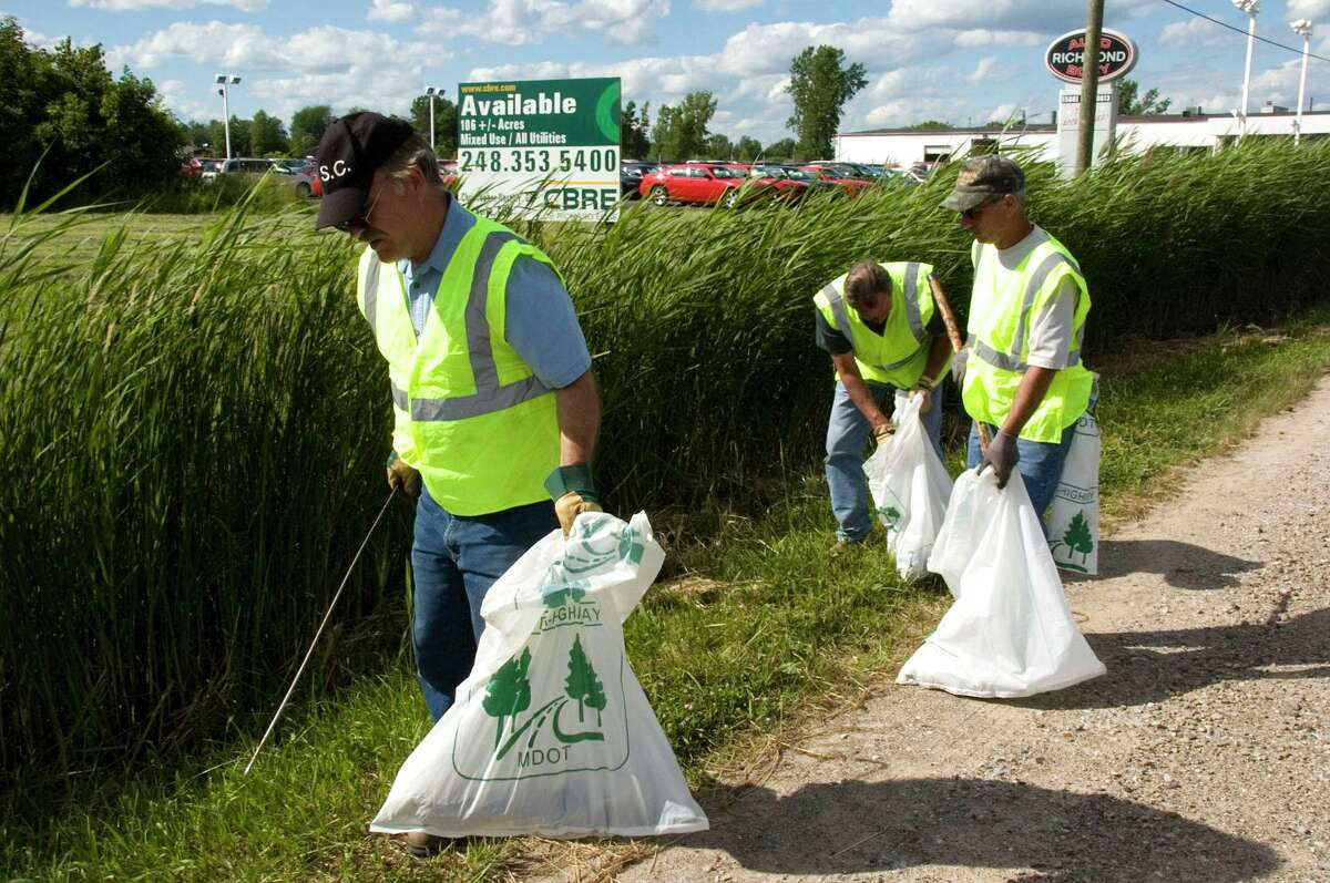 Adopt-A-Highway pickup volunteers in action from previous year.