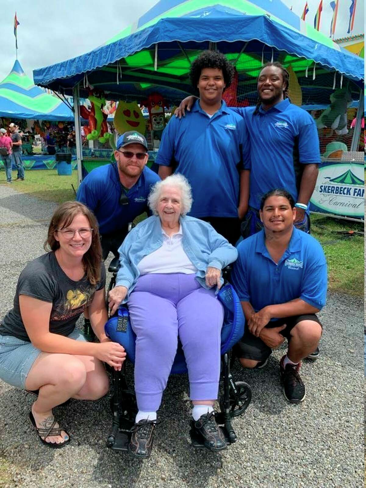 With the help of Skerbeck Family Carnival staff at the Mecosta County Fairgrounds, 95-year-old Mereda Bailey lived her longtime dream of riding the fair's colorful merry-go-round ride. (Courtesy/Nancy Stephan)