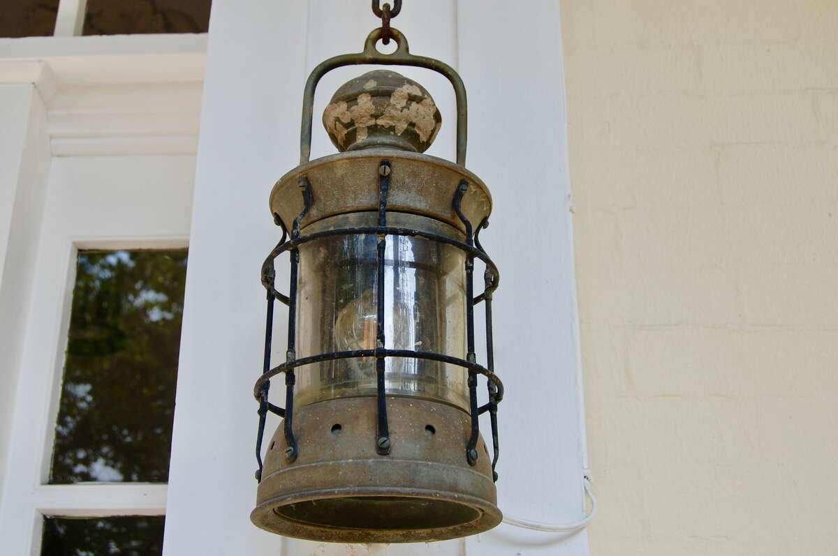 Two smaller lanterns on the outside of the house at 410 Prospect St. are also artifacts from the USS Maine.