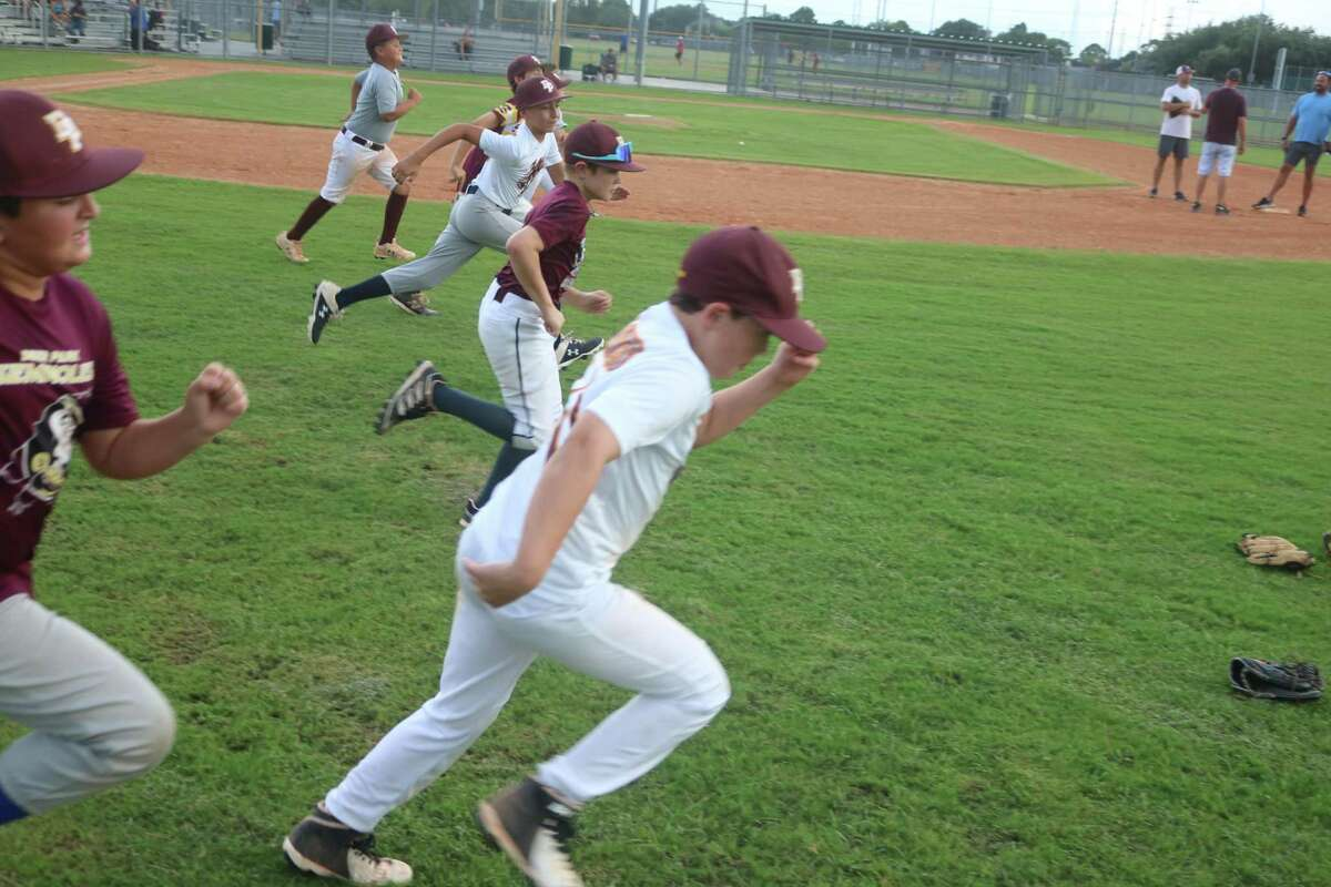 Members of Deer Park's Mustang all-stars test their level of conditioning during Monday night's practice as they prepared for the South Zone tournament's arrival on Wednesday.