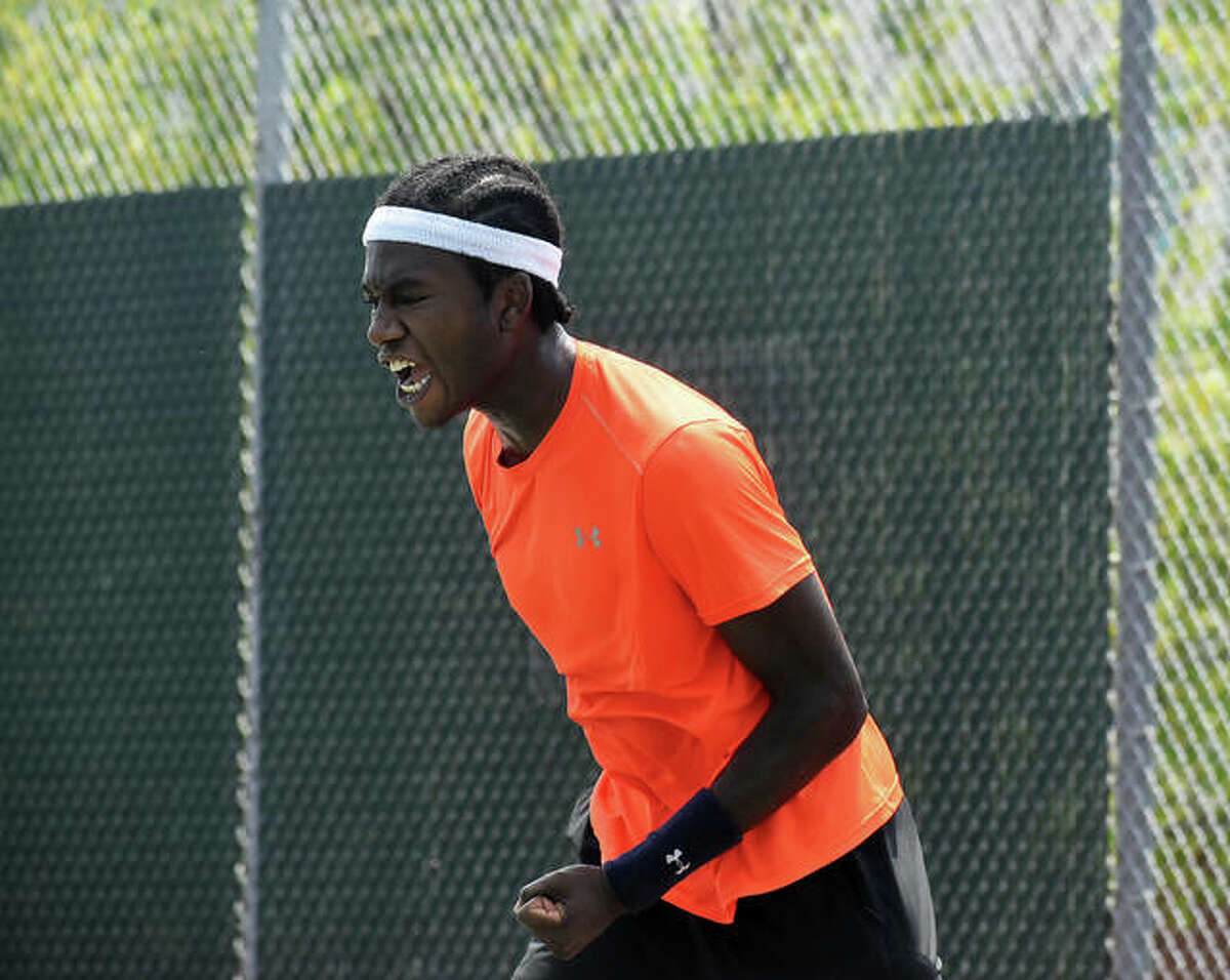 Jibril Nettles celebrates Tuesday after clinching a win over Kalman Boyd inside the EHS Tennis Center to earn a spot in the Main Draw of the Edwardsville Futures tennis tournament.