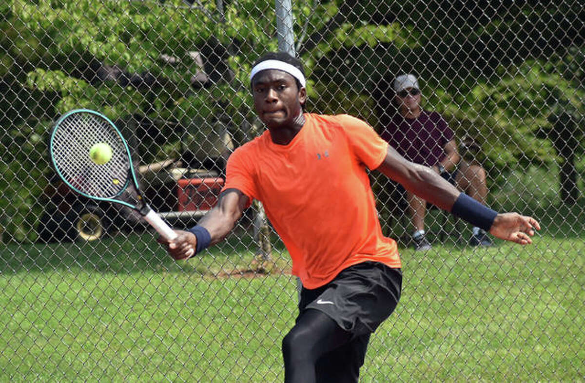 Jibril Nettles finesses a return shot during his match against Kalman Boyd in the second round of the Qualifying Tournament on Tuesday inside the EHS Tennis Center in Edwardsville.