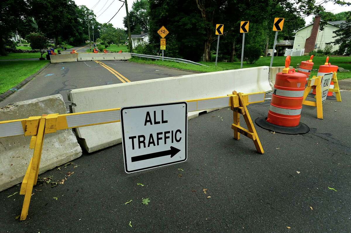 Rowayton Ave is closed at Keelers Brook watercourse bridge Tuesday, July 20, 2021, in Norwalk, Conn. A detour is currently in place at the intersection of Rowayton Avenue and Woodchuck Lane. The road will be closed for three months