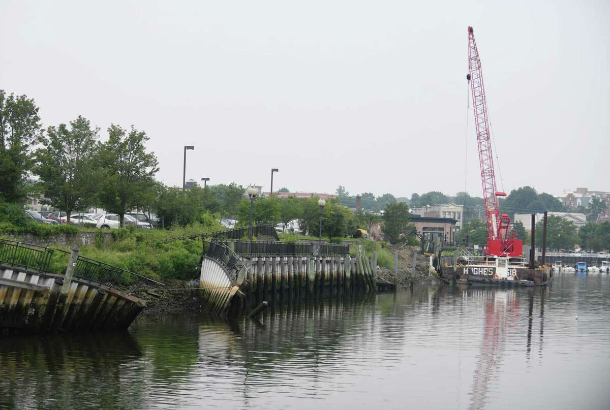 Crews repair the seawall in Port Chester, N.Y. as seen from across the Byram River in Greenwich, Conn. Tuesday, July 20, 2021. Work has begun on the marina bulkhead on the Port Chester side of the river and will take an estimated two years to complete.
