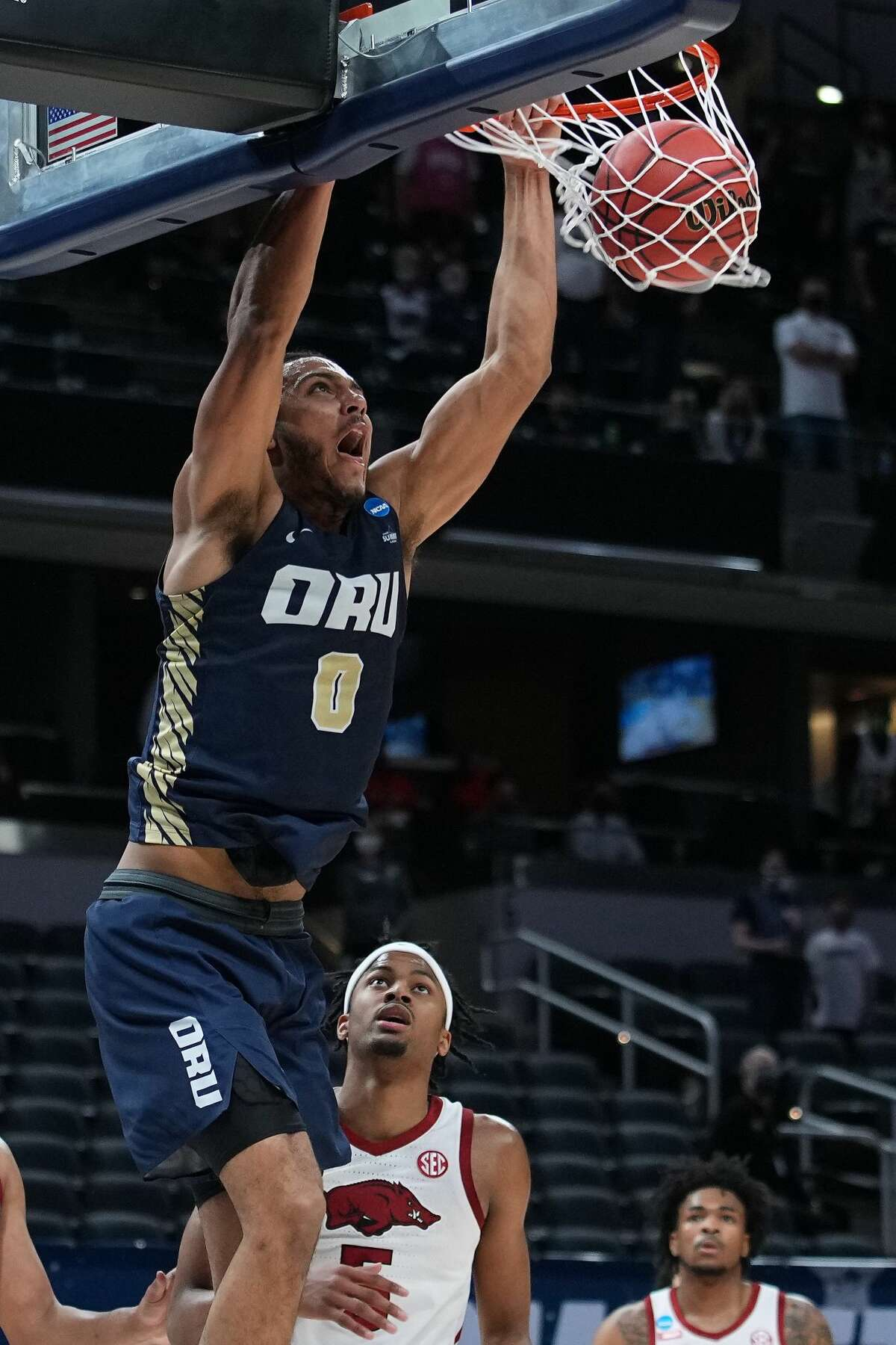 INDIANAPOLIS, IN - MARCH 27: Kevin Obanor #0 of the Oral Roberts Golden Eagles dunks against the Arkansas Razorbacks in the Sweet Sixteen round of the 2021 NCAA Division I Mens Basketball Tournament held at Bankers Life Fieldhouse on March 27, 2021 in Indianapolis, Indiana. (Photo by Jack Dempsey/NCAA Photos via Getty Images)
