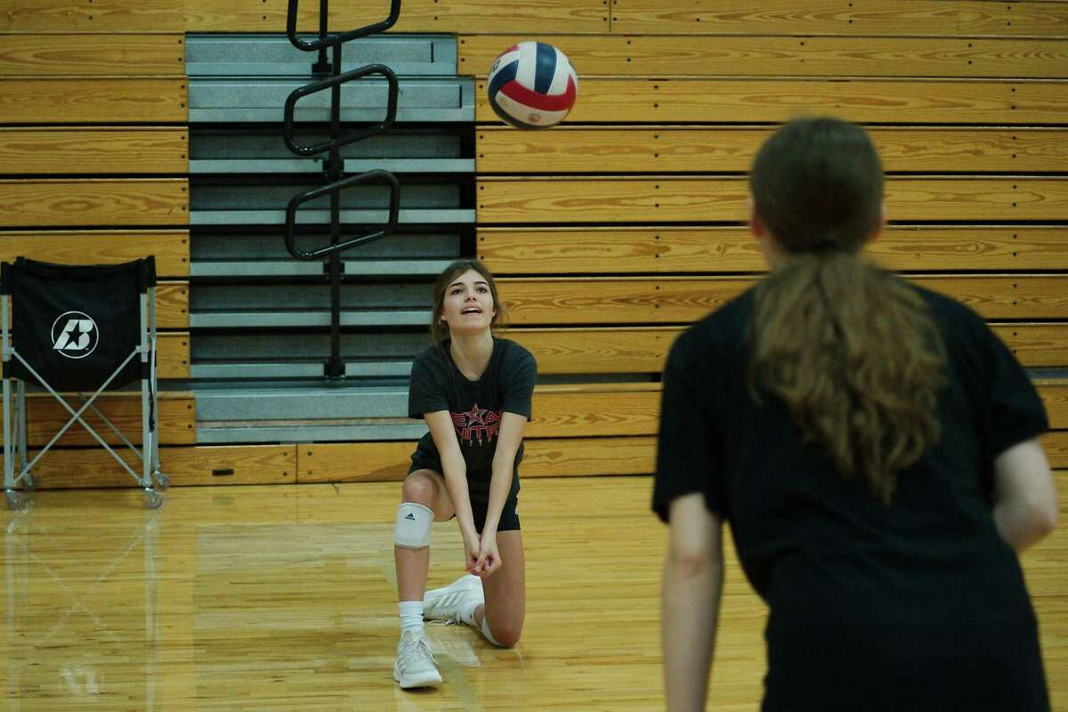 Kaylee Lunsford and Haley Biegay participate in a drill.