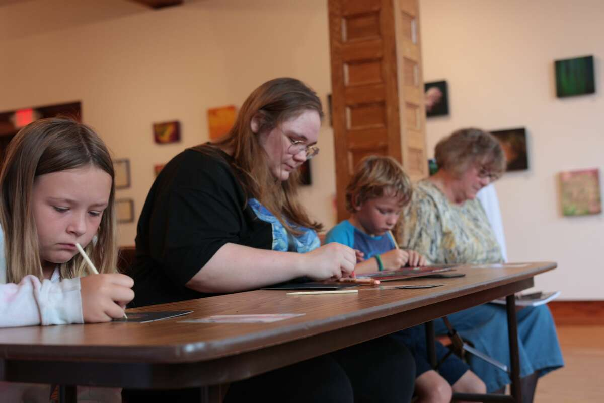 """(From left to right) Emily Wilczynski, Anna Hansen and Mathias Beboni work on creating their own version of """"Picasso's Rooster"""" as part of the Picasso & a Cast of Characters workshop Tuesday in Manistee."""