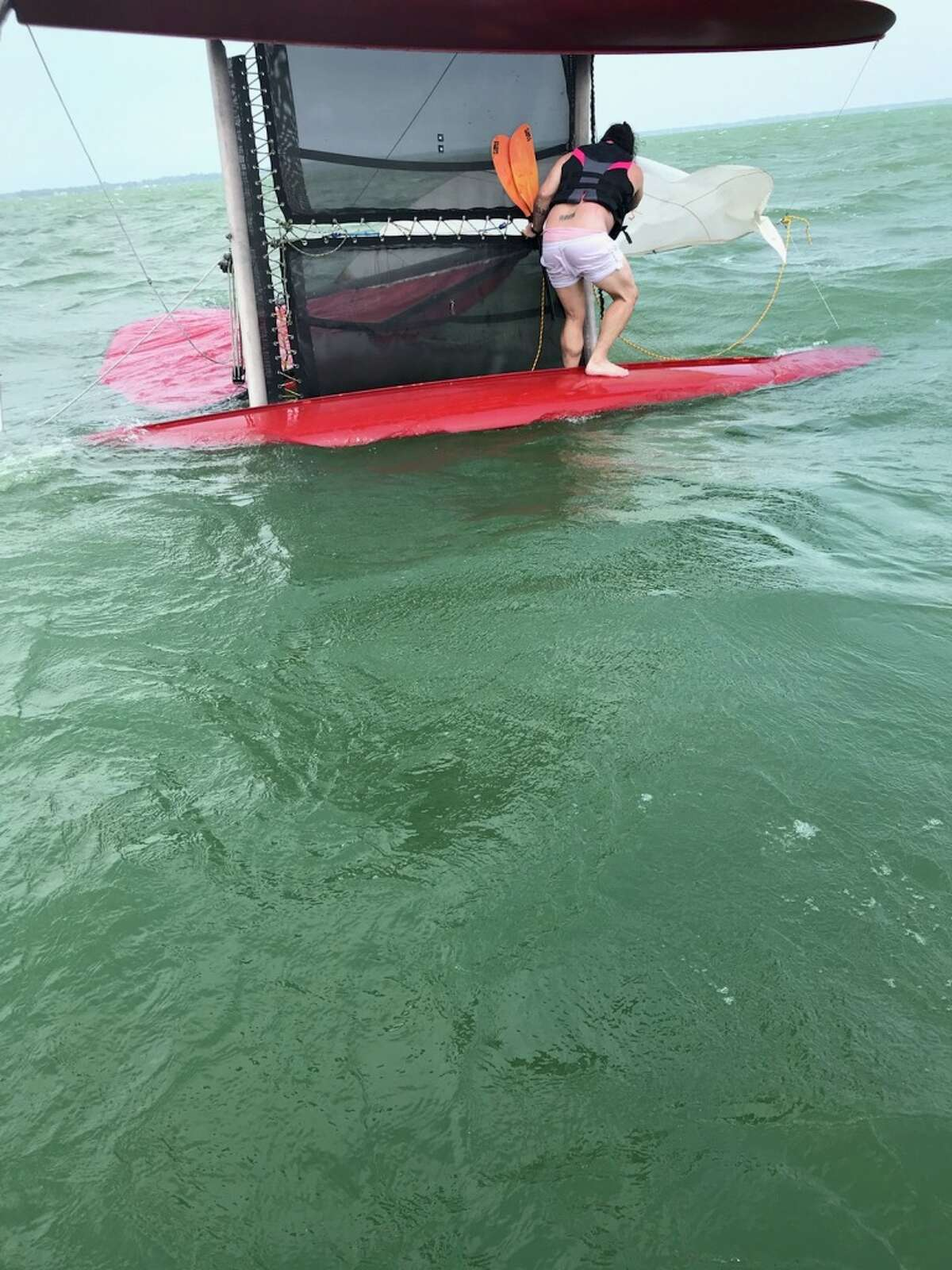 Two boaters were rescued by the Huron County Sheriff's Office after bystanders reported a capsized catamaran July 20.