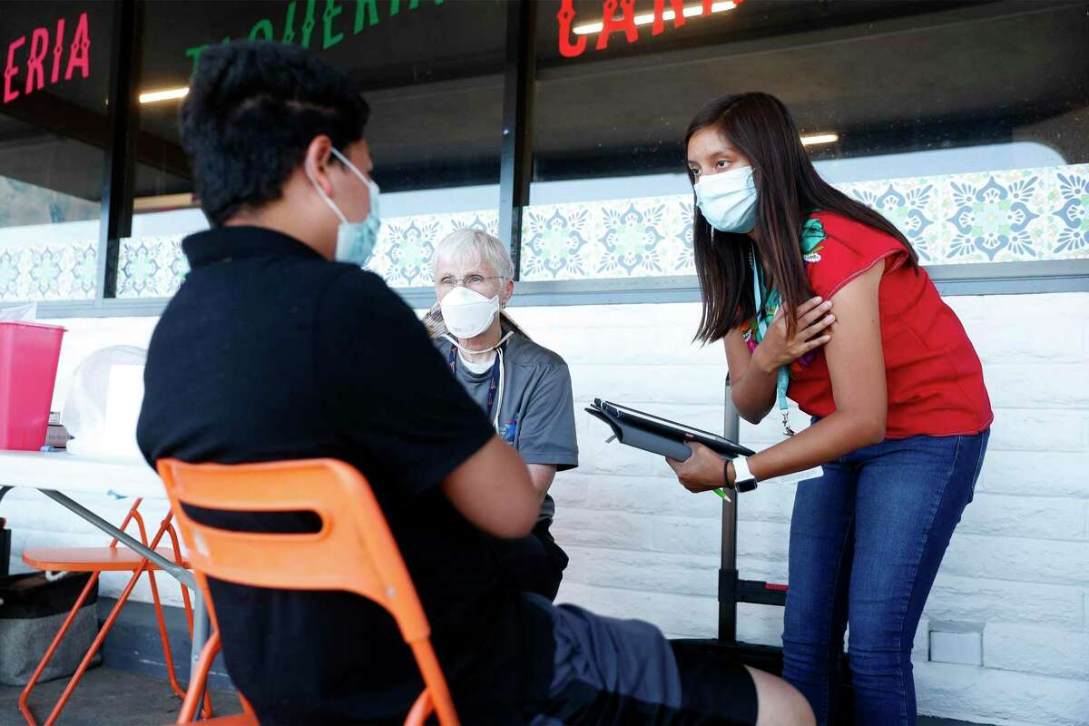 Contra Costra Health Services workers preparing to administer a vaccine last week outside a supermarket in Antioch, which has one of the region's lowest vaccination rates.
