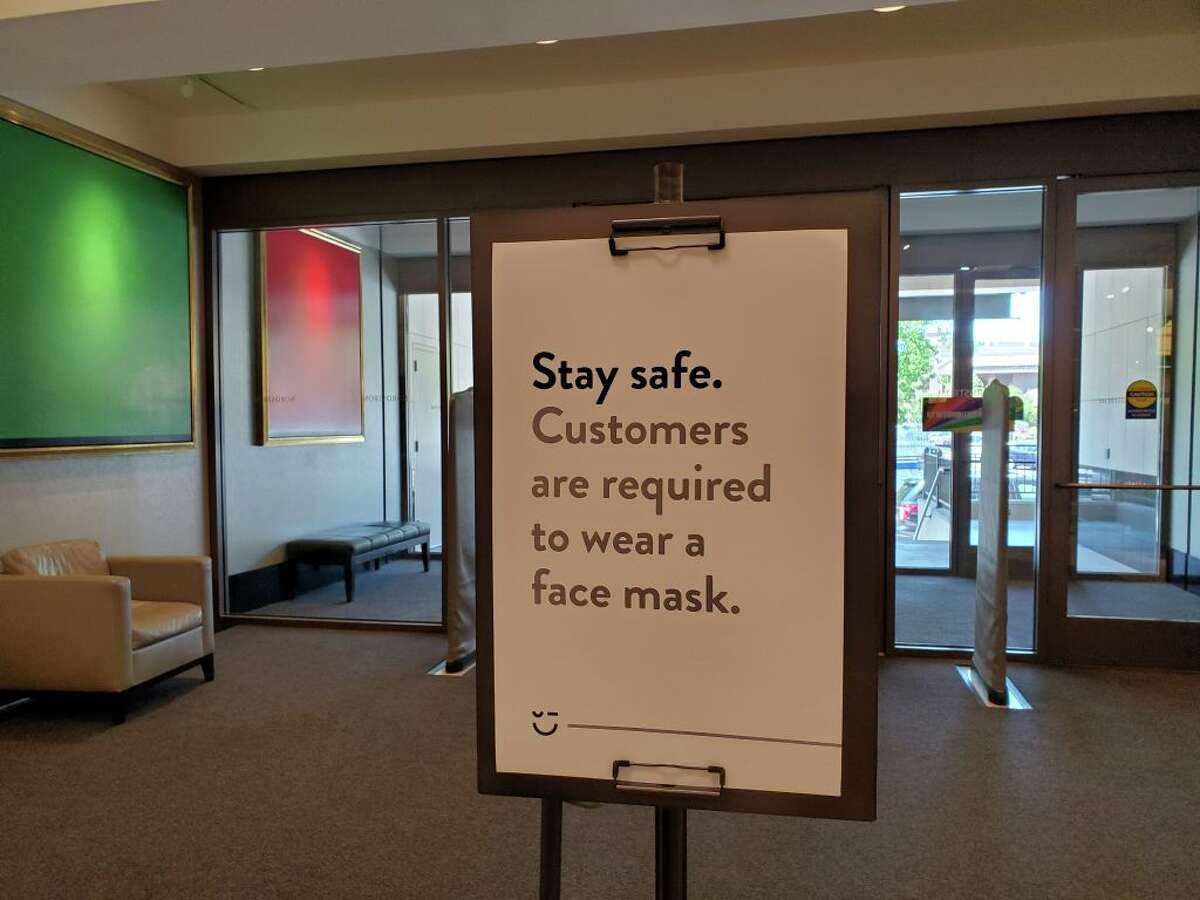 A sign explaining the COVID-19 mass policy at the Nordstrom department store, Walnut Creek, California, June 10, 2021.