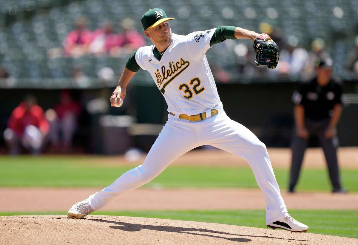 James Kaprielian #32 of the Oakland Athletics pitches against the Los Angeles Angels in the top of the first inning at RingCentral Coliseum on July 20, 2021 in Oakland, California.