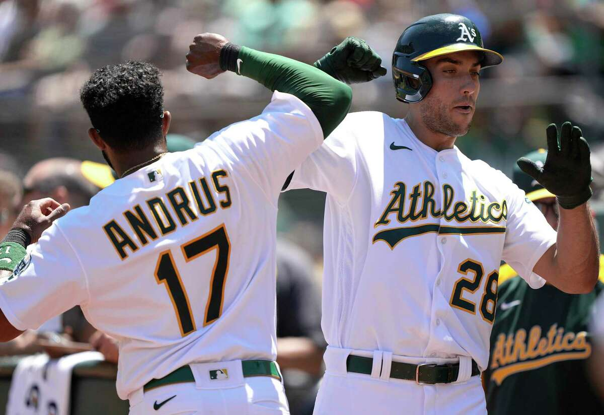 OAKLAND, CALIFORNIA - JULY 20: Matt Olson #28 and Elvis Andrus #17 of the Oakland Athletics celebrates after Olson hit a solo home run against the Los Angeles Angels in the bottom of the fourth inning at RingCentral Coliseum on July 20, 2021 in Oakland, California. (Photo by Thearon W. Henderson/Getty Images)