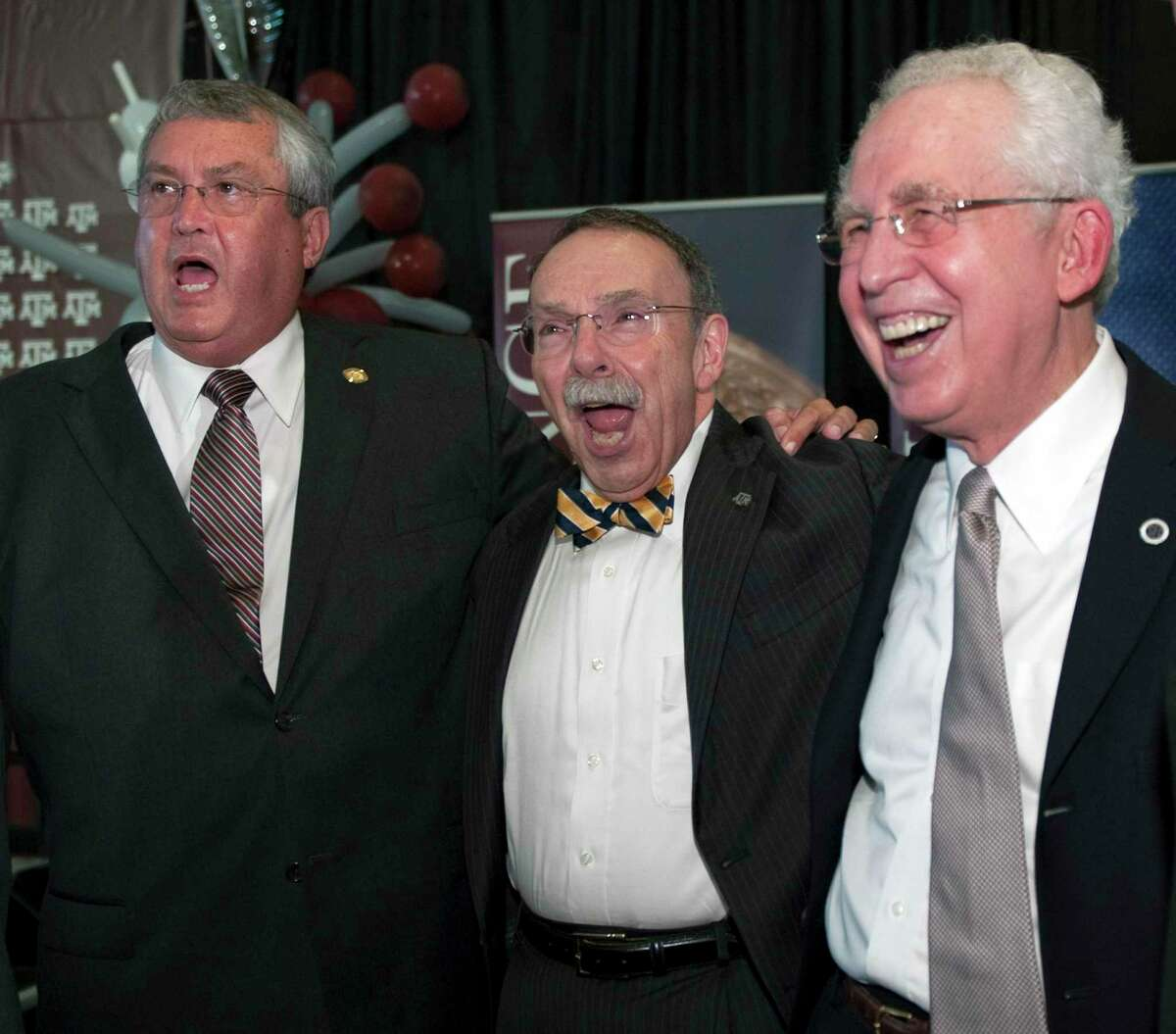 Texas A&M athletic Bill Byrne, left, and school president R. Bowen Loftin, center, celebrate the Aggies' addition to the Southeastern Conference with commissioner Mike Slive in 2011.