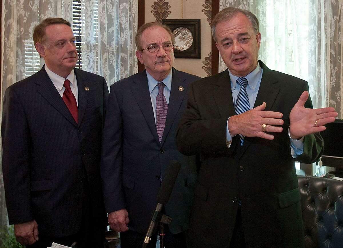Richard Box, center, was the chairman of the Texas A&M Board of Regents when the school made its move to the SEC. Here he names John Sharp as the finalist for chancellor position in 2011. Sharp, too, played a role in moving to the SEC.