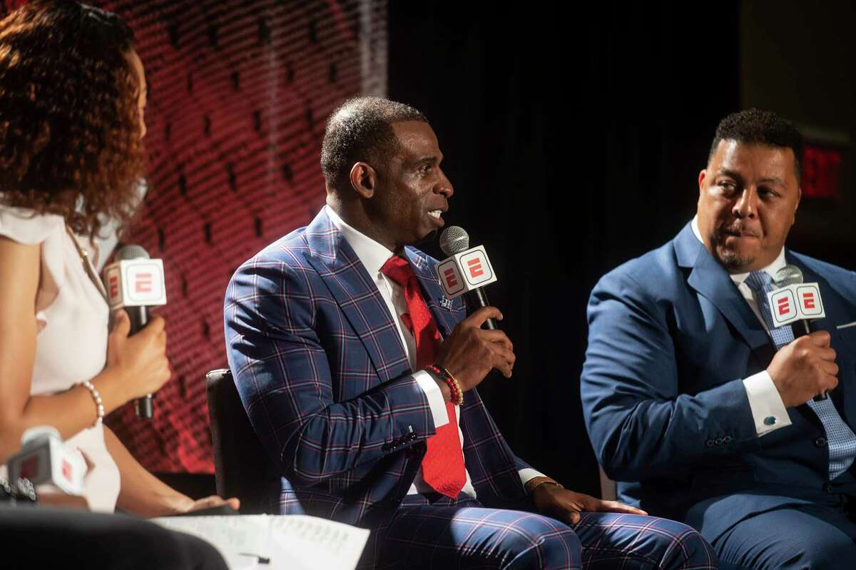 Jackson State coach Deion Sanders (center) wasn't long for SWAC football media days Tuesday after being addressed by his first name.