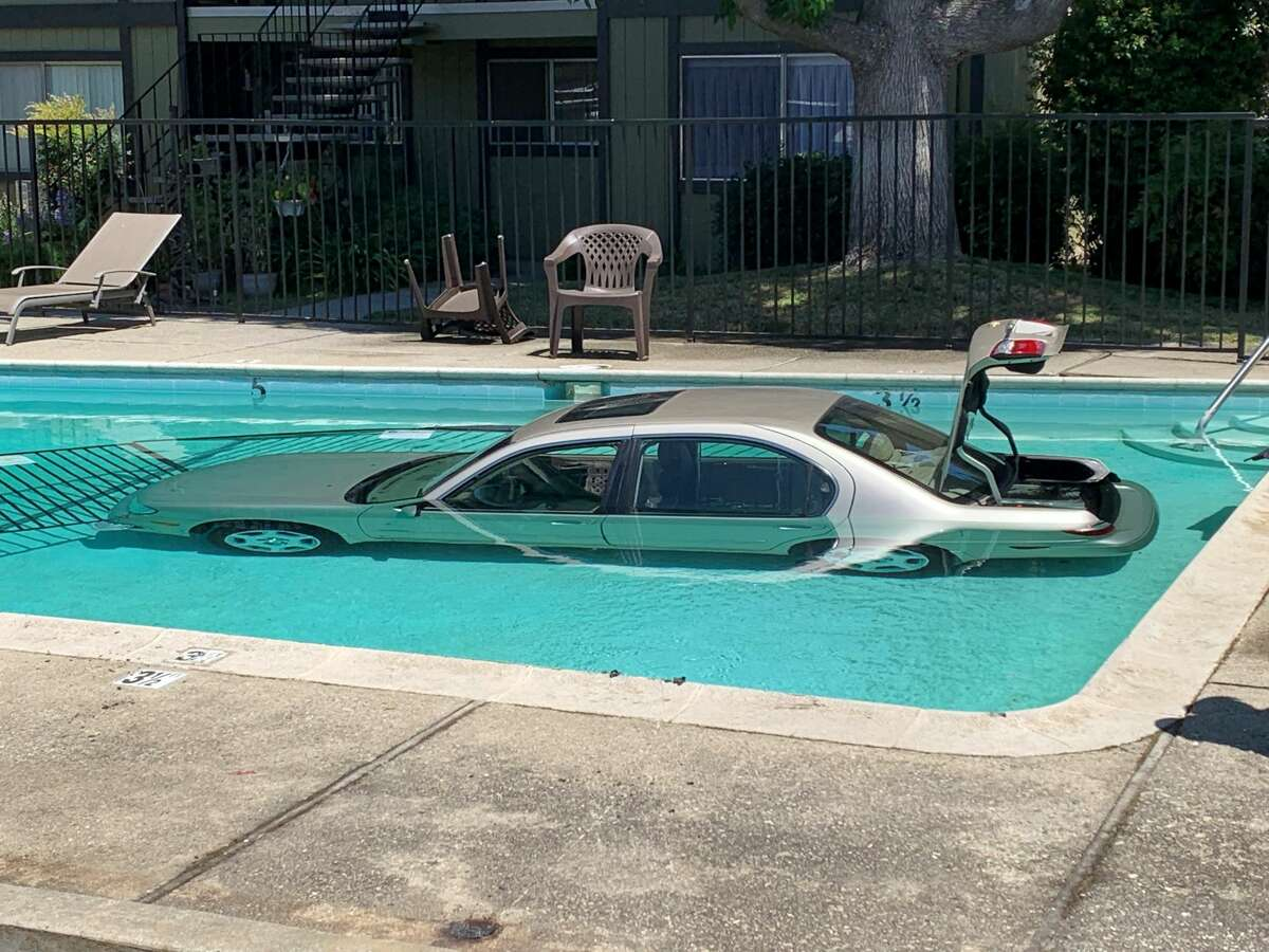 Fire officials arrived to a San Jose apartment complex Tuesday afternoon to see a car wading in the pool.