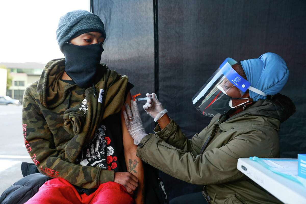 Nurse Sonni Belcher-Collins administers a Johnson & Johnson COVID-19 shot to Vincent Burton in Oakland in March. A new small study indicates the vaccine may not be as effective against the delta variant as the vaccines from Pfizer and Moderna.