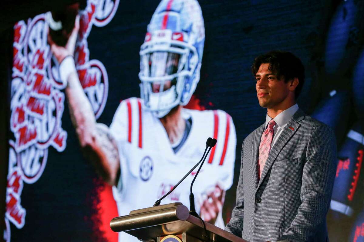 Mississippi's Matt Corral speaks to reporters during a Southeastern Conference Media Days NCAA college football news conference, Tuesday, July 20, 2021, in Hoover, Ala. (AP Photo/Butch Dill)
