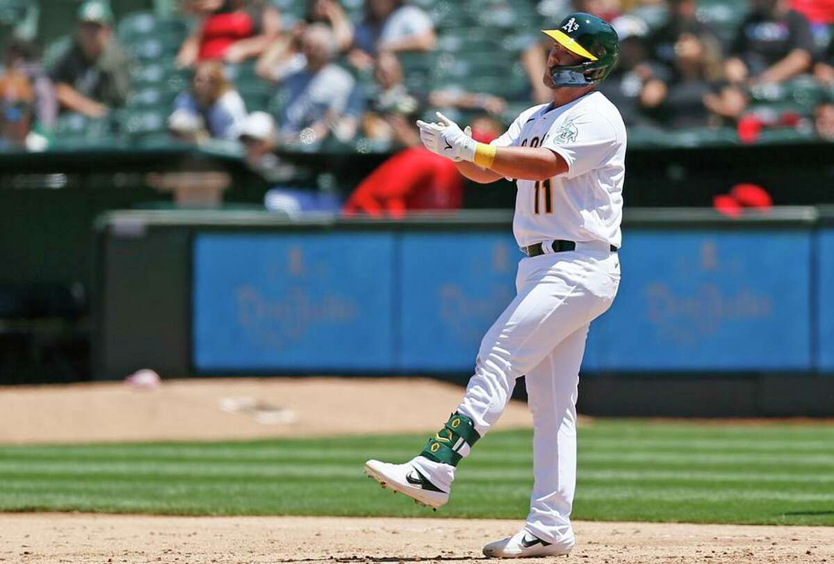 """A's second baseman Jacob Wilson reacts after his base hit in the sixth inning, his first in the majors. Success has """"been a long time coming,"""" said Wilson, who turns 31 on July 29."""