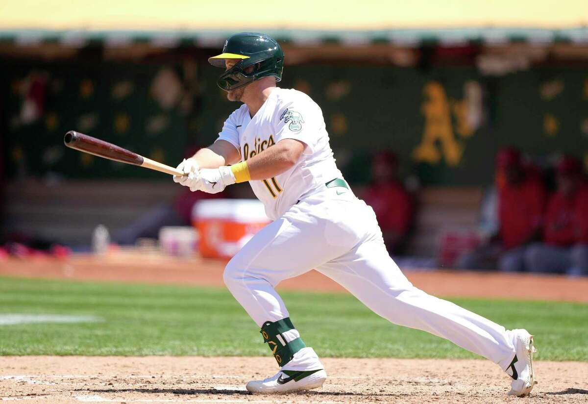 OAKLAND, CALIFORNIA - JULY 20: Jacob Wilson #11 of the Oakland Athletics hits a single up the middle against the Los Angeles Angels in the bottom of the six inning at RingCentral Coliseum on July 20, 2021 in Oakland, California. The single was Wilson's first career Major League hit. (Photo by Thearon W. Henderson/Getty Images)