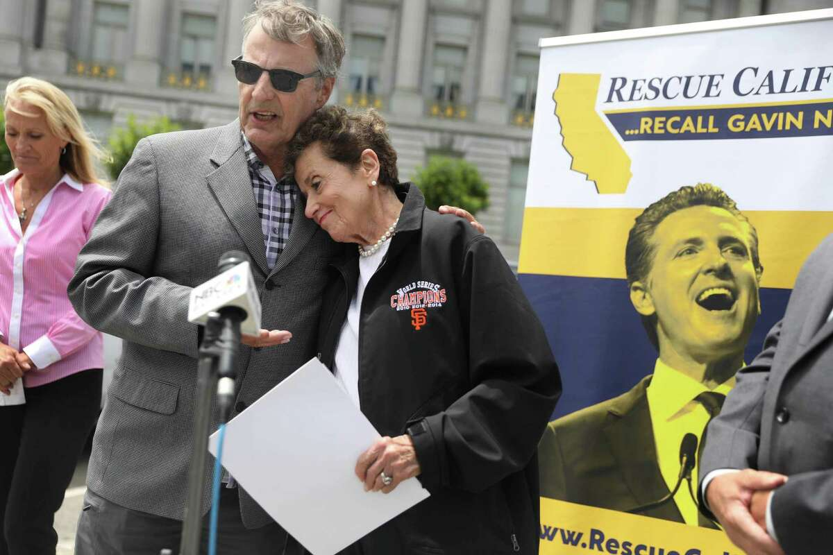 Marc Klaas (left) and Harriet Salarno (right), founder of Crime Victims United of California, hug during a press conference on July 20 outside of San Francisco City Hall advocating for the recall of Gavin Newsom.