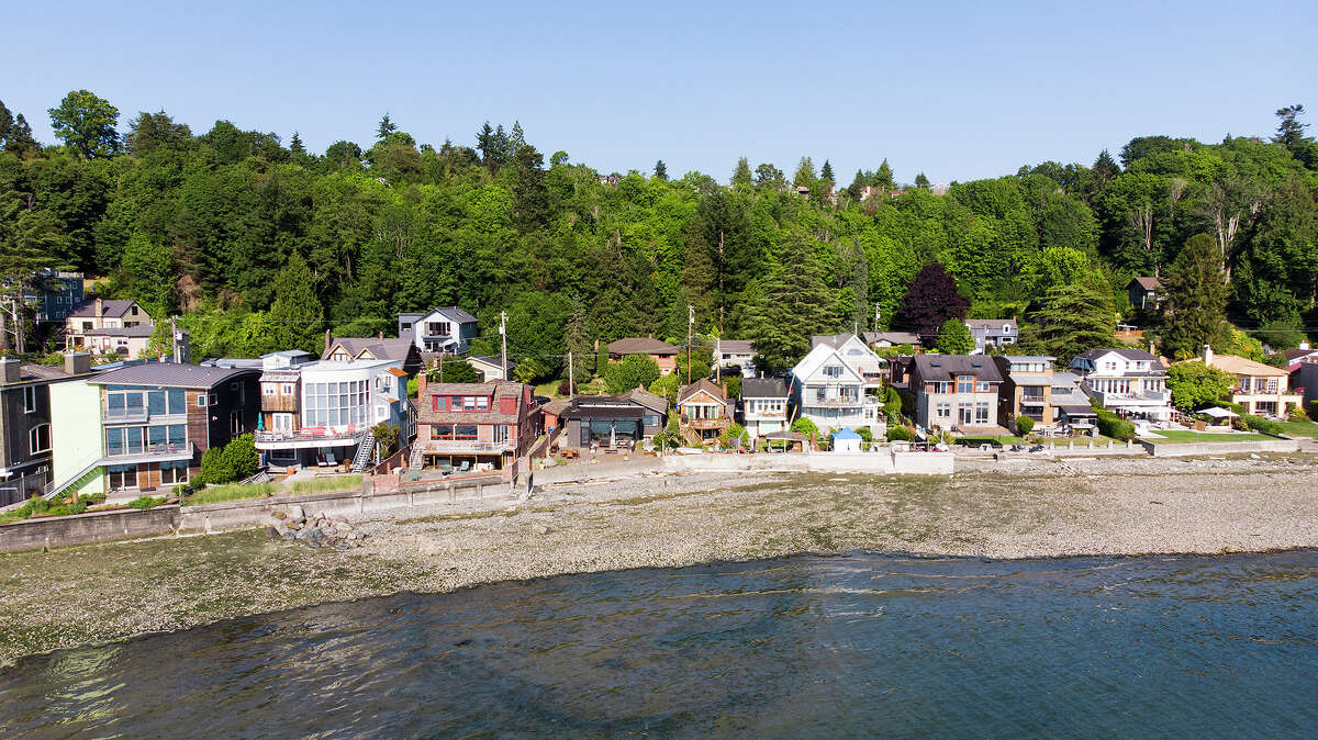 The house joins a lucky community of homes on West Seattle's Beach Drive, facing the water.