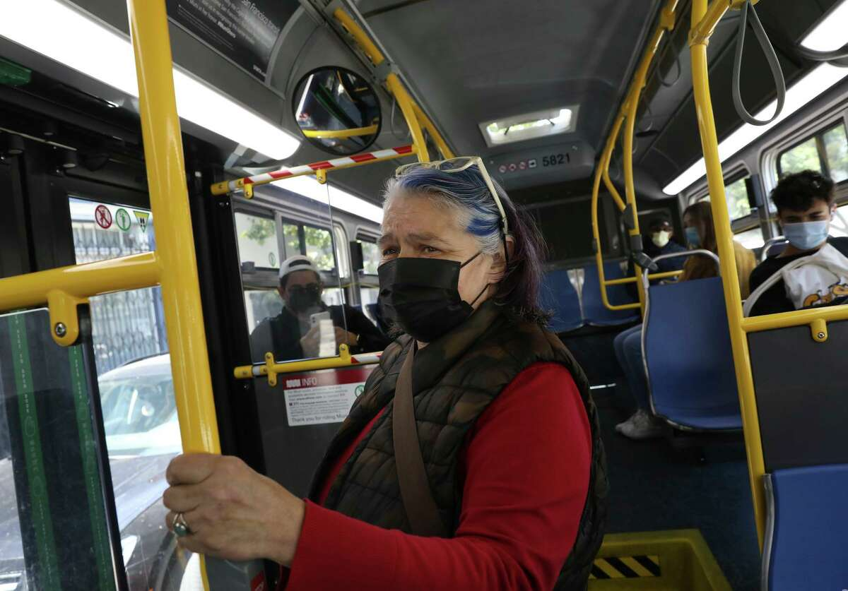 Julia Bauer of San Francisco rides a Muni bus to a second bus stop to run an errand that, before the pandemic, used to take her only one bus ride on the 31-Balboa. Now, with Muni line reductions, the same errand takes her at least two bus rides with longer walks to the bus stops.