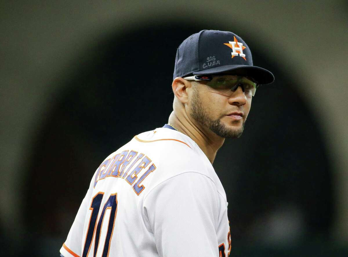"""""""S.O.S. Cuba"""" can be seen written on Houston Astros first baseman Yuli Gurriel's cap before the start of the third inning of an MLB game against Cleveland at Minute Maid Park on Tuesday, July 20, 2021, in Houston."""