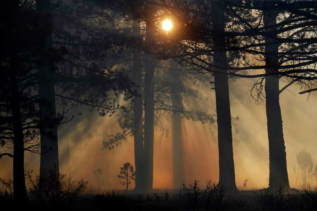 The setting sun shines through wildfire smoke during the Beckwourth Complex Fire in Lassen County.