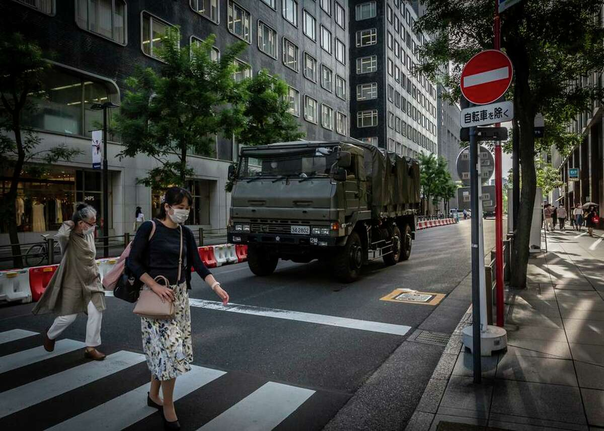 A Japanese self-defense vehicle arrives at Tokyo International Forum, one of the Tokyo Summer Olympics venues.