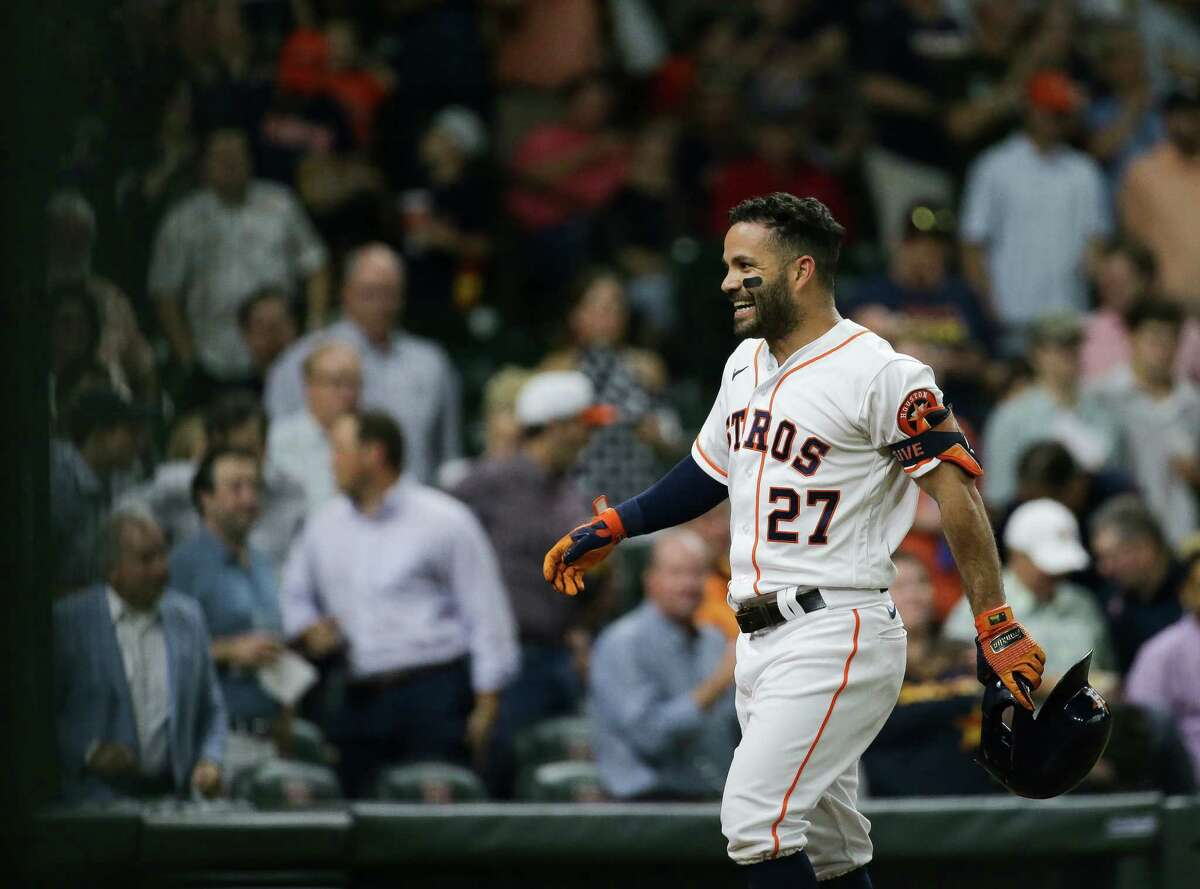 Houston Astros second baseman Jose Altuve (27) smiles after crossing home plate - following his second solo home run against Cleveland - during the third inning of an MLB game at Minute Maid Park on Tuesday, July 20, 2021, in Houston.