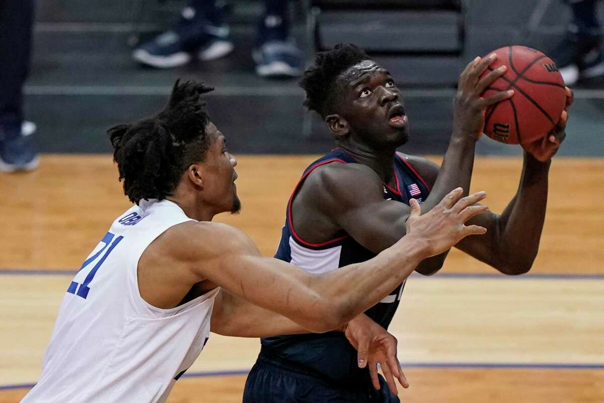 Seton Hall center Ike Obiagu (21) defends against Connecticut forward Adama Sanogo (21) during the second half of an NCAA college basketball game, Wednesday, March 3, 2021, in Newark, N.J. (AP Photo/Kathy Willens)