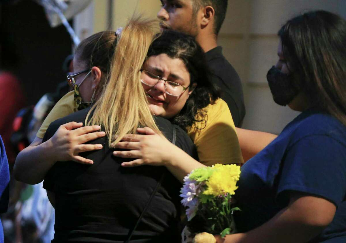 Gabrielle Belmont, identified as Tristian Jaden Rosas' sister, is comforted during a vigil Tuesday evening.