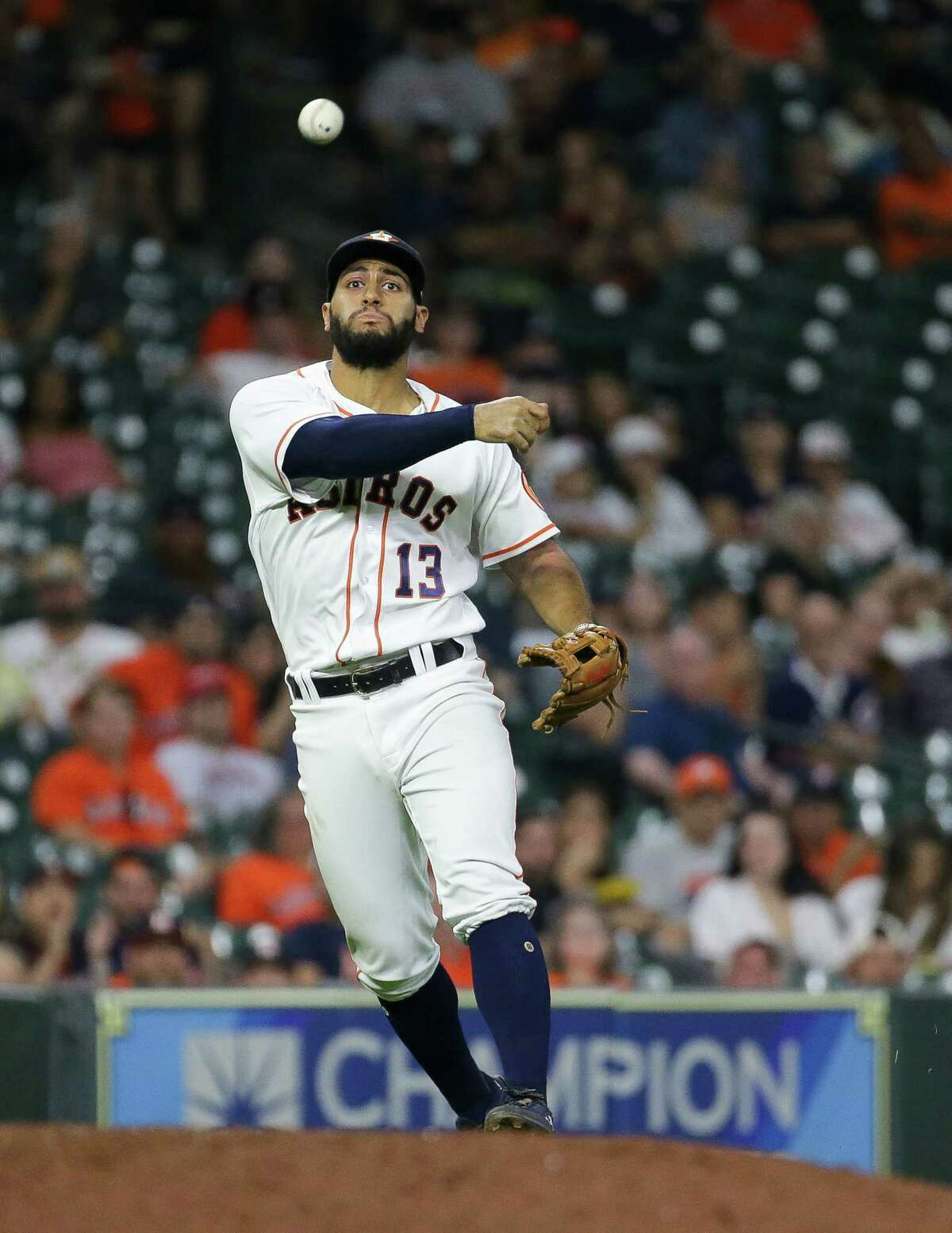 Houston Astros third baseman Abraham Toro (13) throws to first base for an out against Cleveland during the eighth inning of an MLB game at Minute Maid Park on Tuesday, July 20, 2021, in Houston.