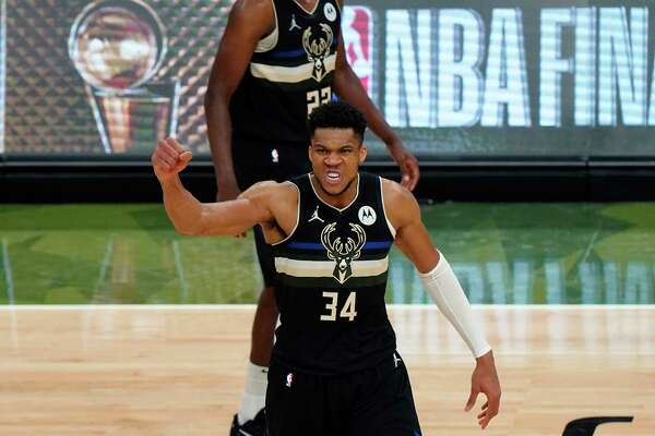Milwaukee Bucks forward Giannis Antetokounmpo (34) reacts during the second half of Game 6 of basketball's NBA Finals against the Phoenix Suns in Milwaukee, Tuesday, July 20, 2021.
