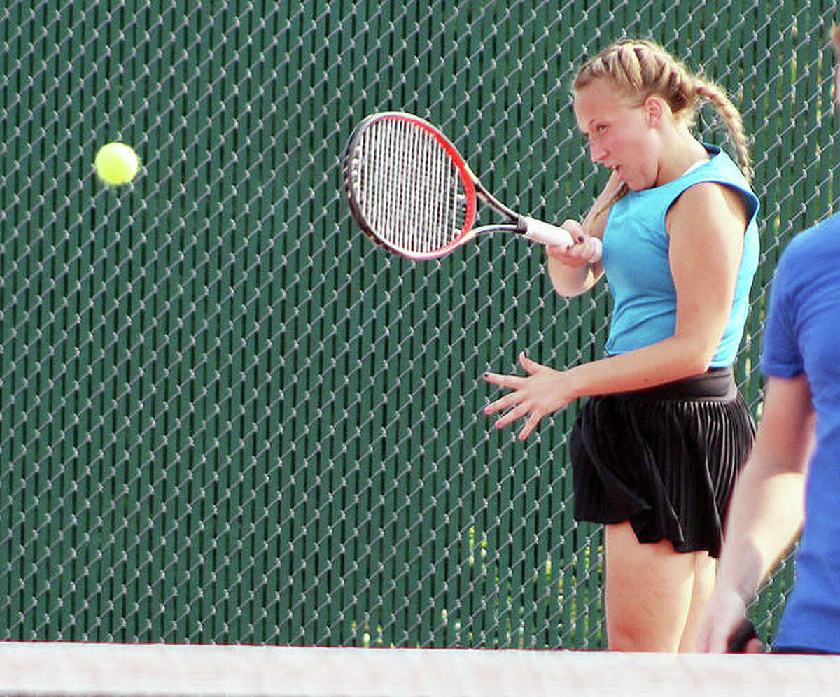 Jessica Schillinger of Civic Memorial makes a return during mixed doubles play Tuesday night at the Riverbend Open tennis tournament at Alton High School.