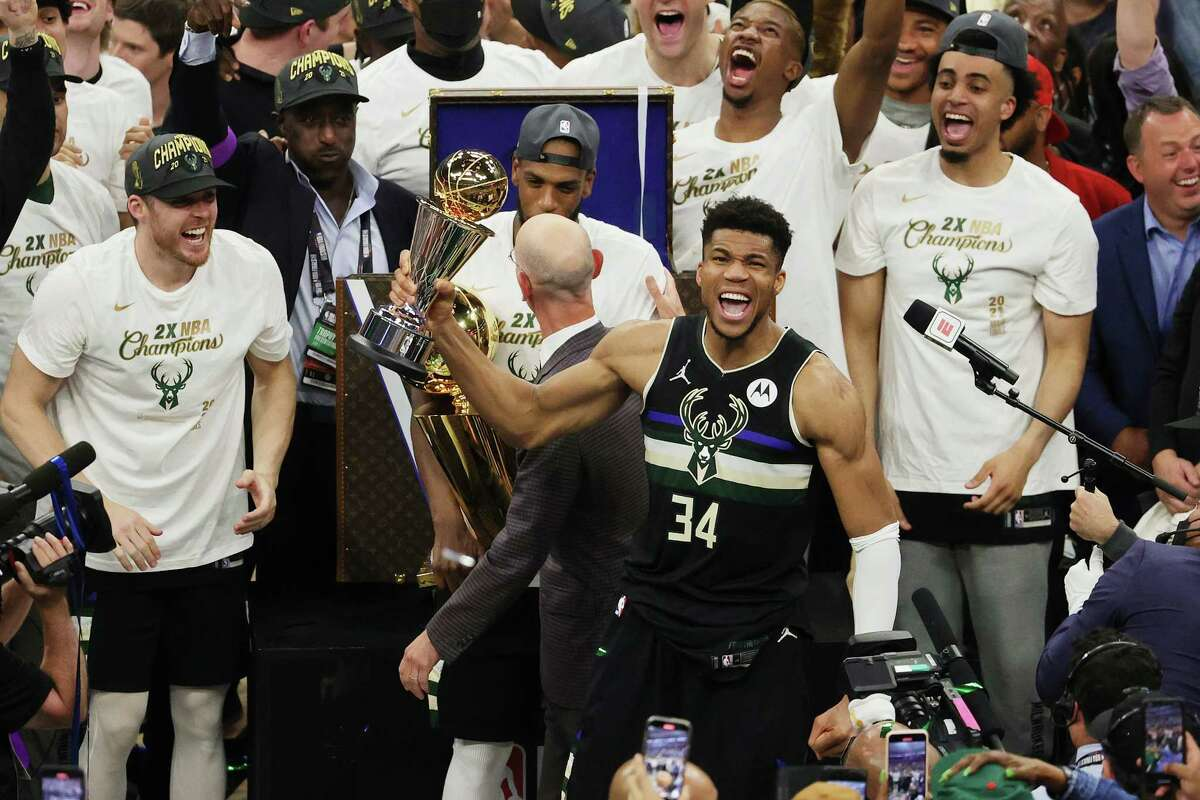 Giannis Antetokounmpo #34 of the Milwaukee Bucks celebrates winning the Bill Russell NBA Finals MVP Award after defeating the Phoenix Suns in Game 6 to win the 2021 NBA Finals at Fiserv Forum on July 20, 2021 in Milwaukee, Wis.