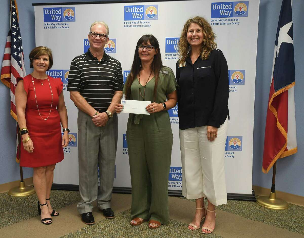 United Way partner agencies, including ARC of Greater Beaumont, pose for a photo after receiving their annual grants Thursday. Photo made Thursday, July 15, 2021 Kim Brent/The Enterprise