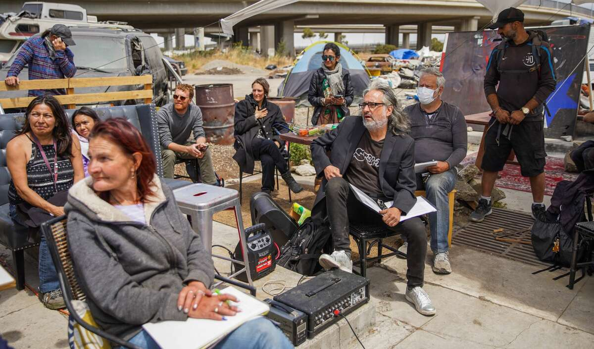 Residents of The Bottoms at Wood Street at a meeting with representatives from the city of Oakland on July 15.
