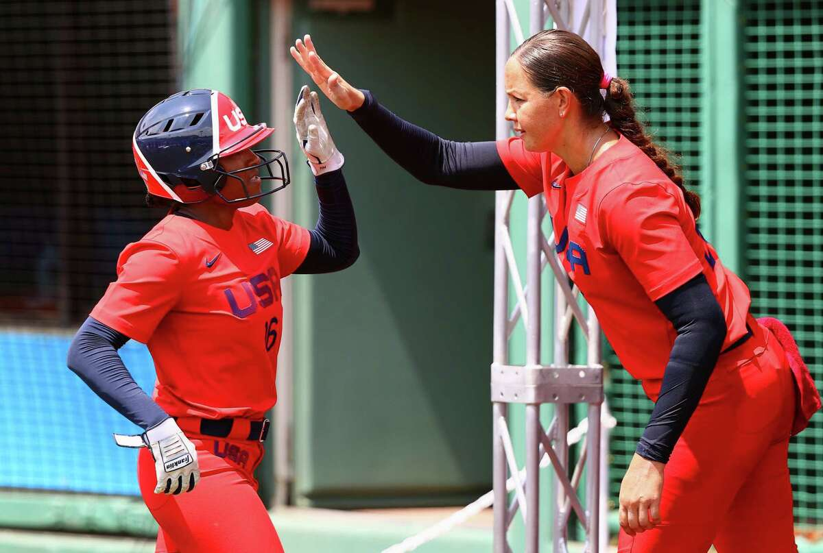 Michelle Moultrie (left)of Team United States is congratulated by teammate Cat Osterman after hitting a sacrifice fly to score a run in the fourth inning against Team Italy during the Tokyo 2020 Olympic Games at Fukushima Azuma Baseball Stadium on July 21, 2021 in Fukushima, Japan.