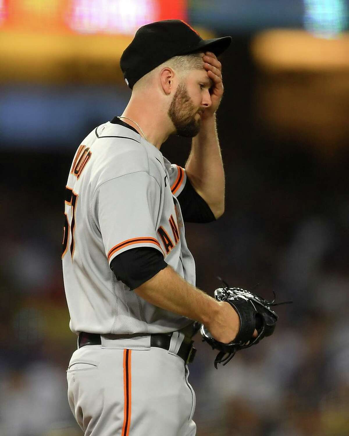 LOS ANGELES, CA - JULY 20: Alex Wood #57 of the San Francisco Giants wipes his brow after hitting two consecutive batters in the fifth inning against the Los Angeles Dodgers at Dodger Stadium on July 20, 2021 in Los Angeles, California. (Photo by Jayne Kamin-Oncea/Getty Images)