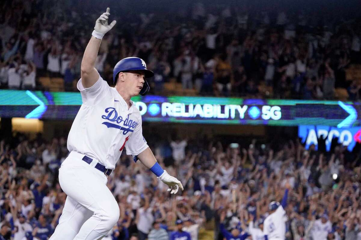 Los Angeles Dodgers' Will Smith celebrates as he rounds first after hitting a three-run walk off home run during the ninth inning of a baseball game against the San Francisco Giants Tuesday, July 20, 2021, in Los Angeles. (AP Photo/Mark J. Terrill)