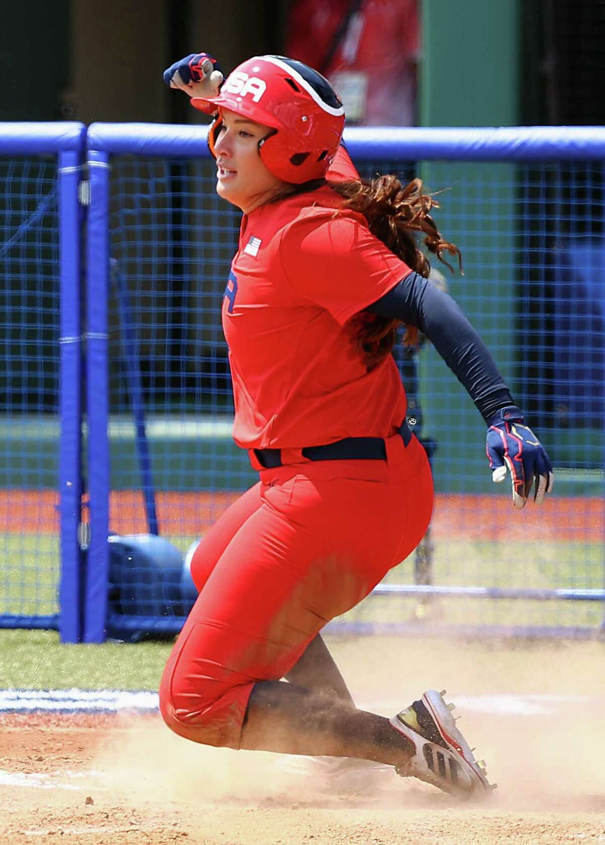 FUKUSHIMA, JAPAN - JULY 21: Valerie Arioto #20 of Team United States finishes her slide into home plate to score in the fourth inning against Team Italy during the Tokyo 2020 Olympic Games at Fukushima Azuma Baseball Stadium on July 21, 2021 in Fukushima, Japan. (Photo by Yuichi Masuda/Getty Images)
