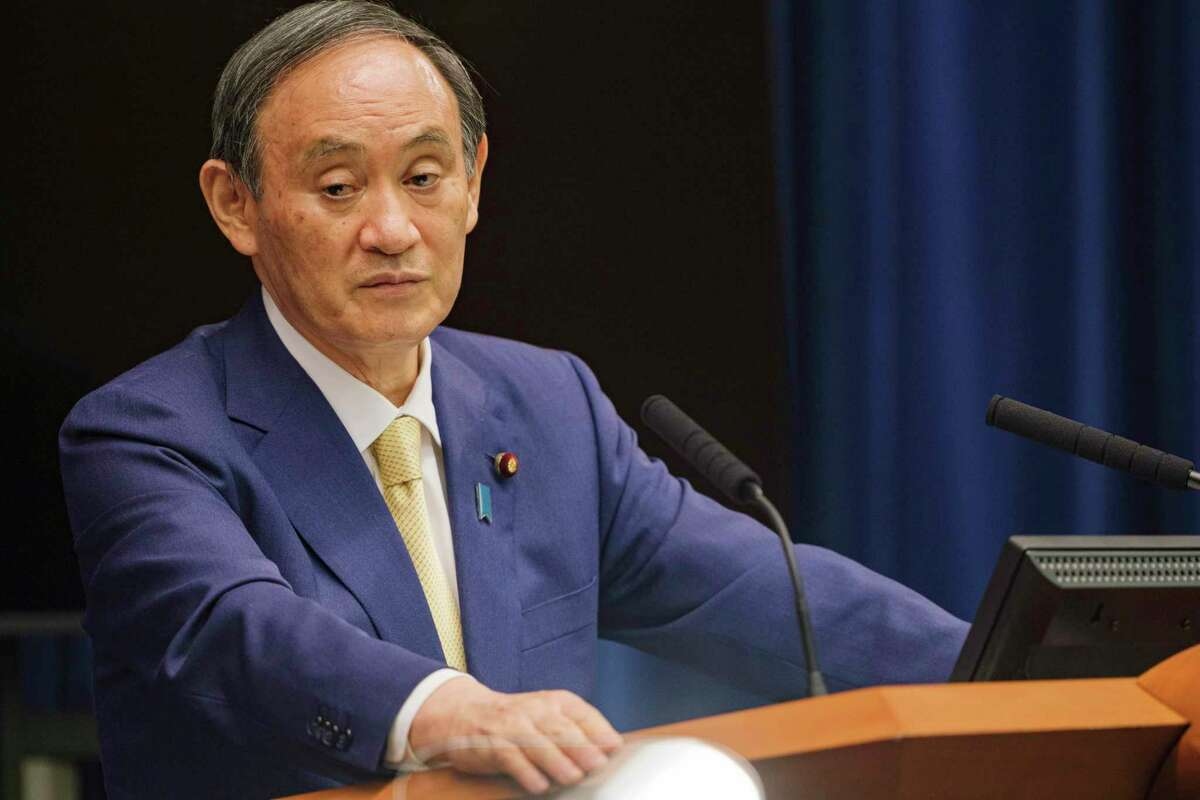 FILE - In this July 8, 2021, file photo, Japan's Prime Minister Yoshihide Suga speaks during a news conference at his official residence in Tokyo. The Tokyo Olympics are going ahead despite opposition from many quarters inside Japan. The Japanese medical community is largely against it. (Nicolas Datiche/Pool Photo via AP, File)