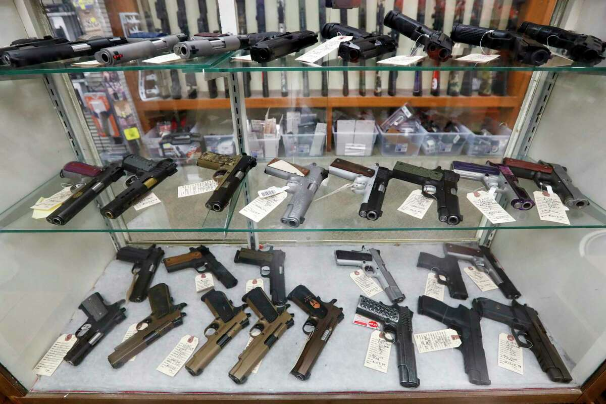 Semi-automatic handguns are displayed at shop in New Castle, Pa.