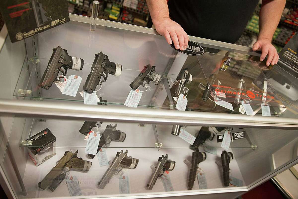 Customers shop for a handgun at Metro Shooting Supplies in Bridgeton, Miss.